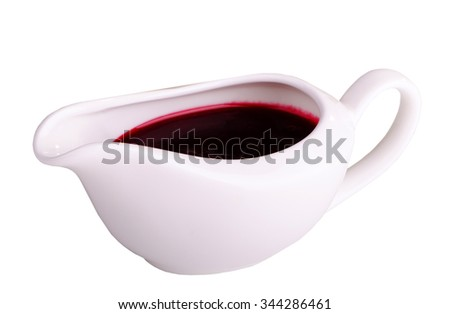 berry sauce in a gravy boat isolated on white background - stock photo