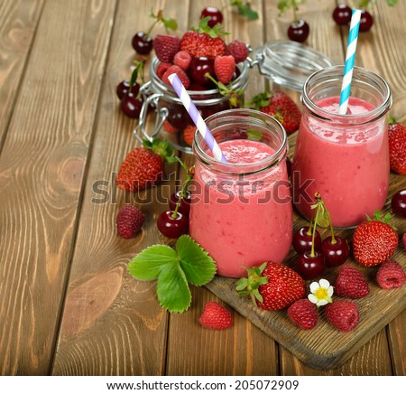 berry smoothie on brown background - stock photo