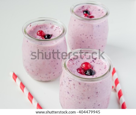 Berry smoothie on white background