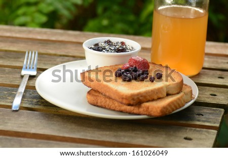 berry toast with jam and apple juice - stock photo