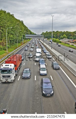 BERTEM, BELGIUM -AUGUST 12, 2014: Illustration picture shows lots of car stucked by seasonal works in Bertem cloverleaf, on the highway E40 between Brussels and Liege on 12 august 2014