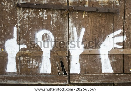 """BESALU, SPAIN - OCTOBER 9, 2014: Curious painted hands simulating sign language, forming the word """"love"""". - stock photo"""