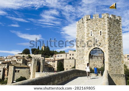 BESALU, SPAIN - OCTOBER 9, 2014: Detail of medieval bridge, ancient entrance to the historic center of the village. - stock photo
