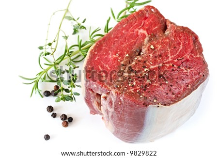 Best cut of beef fillet steak, ready for cooking.  With peppercorns, rosemary and thyme. - stock photo