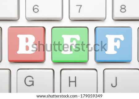 Best friend forever key on keyboard - stock photo
