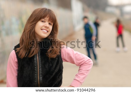 Best friends enjoying each others company in the urban surrounding on beautiful autumn day. - stock photo