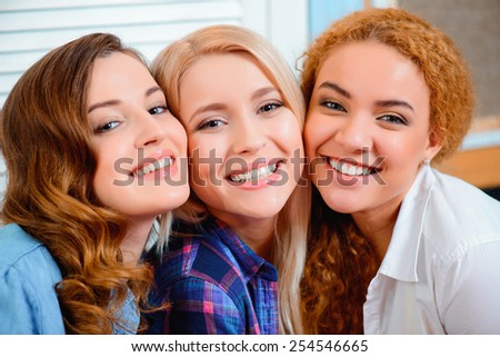 Best friends for life. Two young beautiful female friends sitting in cafe and bonding to each other  - stock photo