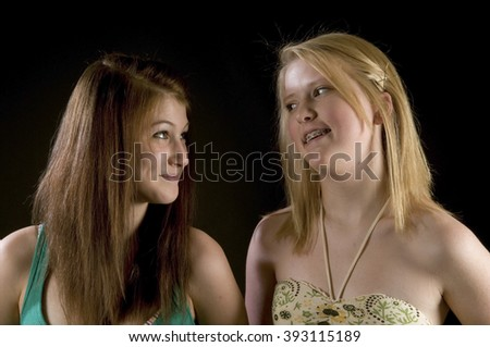 Best Friends Forever - two pretty teenage girls enjoying each other, laughing, smiling