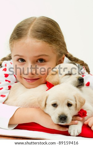 Best friends - happy girl with cute puppies - stock photo