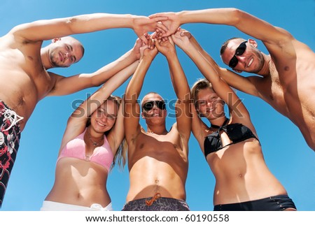 best friends having a laugh on the beach - stock photo