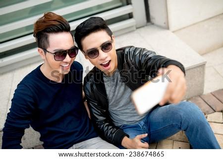 Best friends in sunglasses taking selfie - stock photo