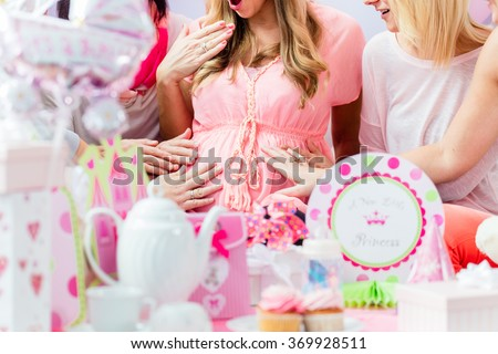 Best Friends on baby shower party celebrating giving kid stuff as present - stock photo