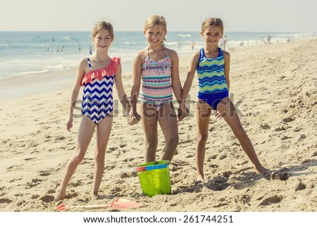 Best friends playing together at the Beach - stock photo