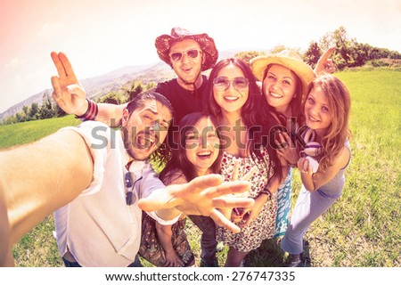 Best friends taking selfie at countryside picnic - Happy friendship concept and fun with young people and new technology trends - Vintage filter look with marsala color tones - Fisheye lens distortion - stock photo