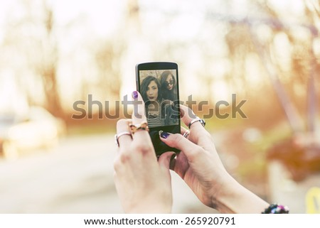 Best friends taking Selfie With Mobile Phone