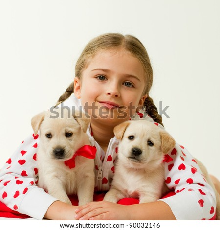 Best friends - young girl with cute labrador puppies - stock photo