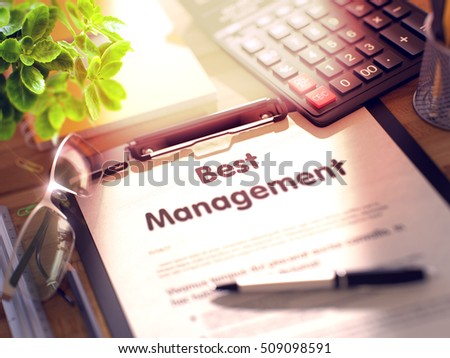 Best Management- Text on Clipboard with Office Supplies on Desk. 3d Rendering. Blurred Image.