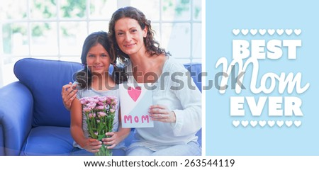 best mom ever against cute girl offering flowers and card to her mother - stock photo