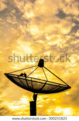 Best signal with satellite dish and couple birds on sunset time - stock photo