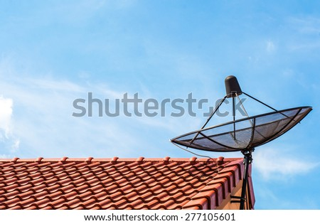 Best signal with satellite dish on the roof at home - stock photo