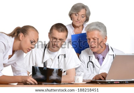 Best team of doctors at work with computer - stock photo