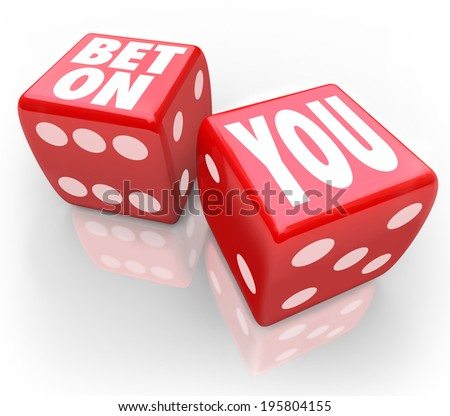 Bet On You words on two red dice self confidence and following your dreams - stock photo