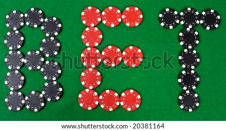 Bet - word build using red and black poker chips. Green poker table.