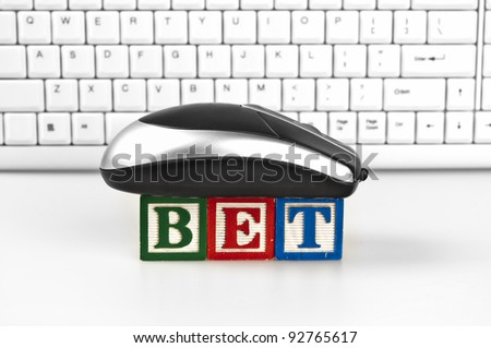 Bet word with mouse and keyboard - stock photo
