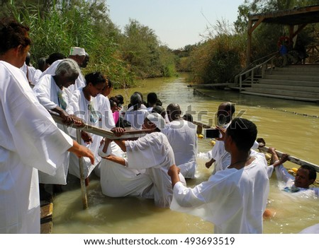 Bethabara, Israel - August 23, 2016: Pilgrims from Ethiopia are dipped into sacred water of the Jordan River.