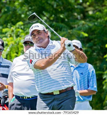 BETHESDA, MD - JUNE 13: Angel Cabrera, former US Open and Masters Champion, hits his drive off the 16th hole on Congressional at the 2011 US Open on June 13, 2011 in Bethesda, MD. - stock photo