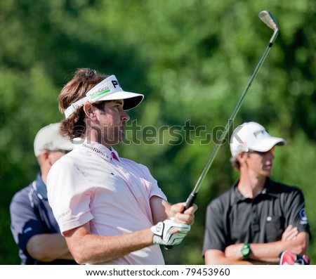 BETHESDA, MD - JUNE 13: Bubba Watson hits a shot at Congressional during the 2011 US Open on June 13, 2011 in Bethesda, MD. - stock photo