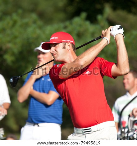 BETHESDA, MD - JUNE 14: Dustin Johnson hits a shot at Congressional during the 2011 US Open on June 14, 2011 in Bethesda, MD. - stock photo
