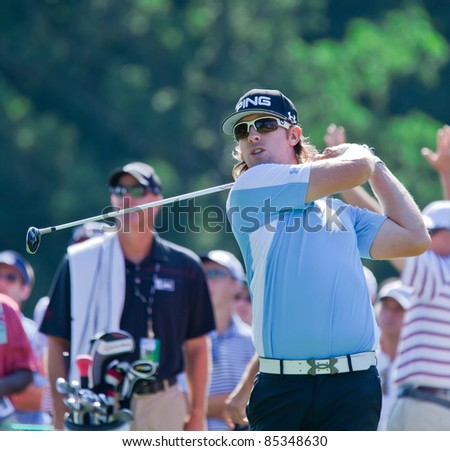 BETHESDA, MD - JUNE 14:  Hunter Mahan hits a shot at Congressional during the 2011 US Open on June 14, 2011 in Bethesda, MD. - stock photo