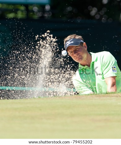 BETHESDA, MD - JUNE 15: Luke Donald blasts a sand shot at Congressional during the 2011 US Open on June 15, 2011 in Bethesda, MD. - stock photo