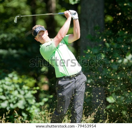 BETHESDA, MD - JUNE 15: Luke Donald hits a shot at Congressional during the 2011 US Open on June 15, 2011 in Bethesda, MD. - stock photo