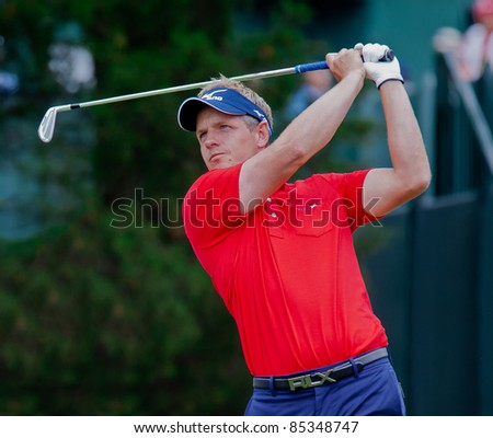 BETHESDA, MD - JUNE 14: Luke Donald hits a shot at Congressional during the 2011 US Open on June 14, 2011 in Bethesda, MD. - stock photo