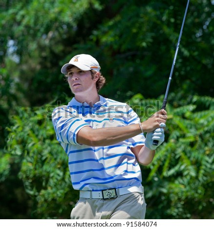 BETHESDA, MD - JUNE 13: Peter Uihlein, the 2010 U.S Amateur Champion, hits a shot at Congressional during the 2011 US Open on June 13, 2011 in Bethesda, MD. Peter recently announced he would turn pro. - stock photo