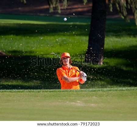 BETHESDA, MD - JUNE 13: Rickie Fowler blasts a a sand shot onto the 6th hole at Congressional during the 2011 US Open on June 13, 2011 in Bethesda, MD. - stock photo