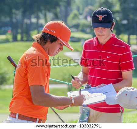 BETHESDA, MD - JUNE 13: Rickie Fowler signs an autograph for fans at Congressional during the 2011 US Open on June 13, 2011 in Bethesda, MD. - stock photo