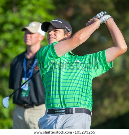 BETHESDA, MD - JUNE 14: Young amateur, Beau Hossler, hits a shot at Congressional during the 2011 US Open on June 14, 2011 in Bethesda, MD. - stock photo