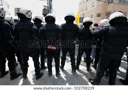 BETHLEHEM, PALESTINIAN TERRITORIES - MARCH 30: Riot police of the Palestinian Authority block access to the Bethlehem checkpoint during Land Day demonstrations on March 30, 2012.