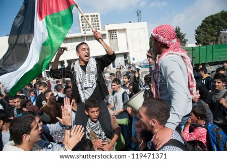 BETHLEHEM, PALESTINIAN TERRITORY - NOVEMBER 20: Palestinians students rally in Bethlehem's Manger Square to protest Israeli attacks on Gaza, November 20, 2012. - stock photo