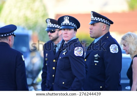 BETHPAGE, LONG ISLAND - MAY 7 2015: a formal viewing for slain NYPD officer Brian Moore, attended by thousands of police officers from North America. Chicago Police representatives - stock photo