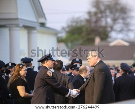 BETHPAGE, LONG ISLAND - MAY 7 2015: a formal viewing for slain NYPD officer Brian Moore, attended by thousands of police officers from North America. Timothy Cardinal Dolan arrives in Bethpage - stock photo