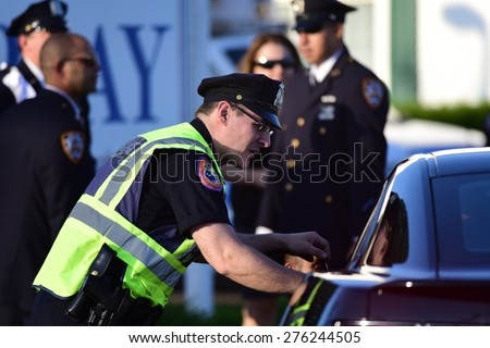 BETHPAGE, LONG ISLAND - MAY 7 2015: a formal viewing for slain NYPD officer Brian Moore, attended by thousands of police officers from North America.  - stock photo