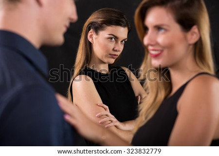 Betrayal concept - beauty woman seducing attractive man - stock photo