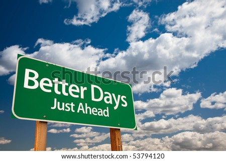 Better Days, Just Ahead Green Road Sign with Copy Room Over The Dramatic Clouds and Sky. - stock photo