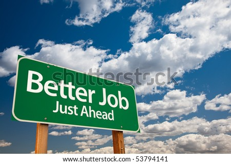 Better Job, Just Ahead Green Road Sign with Copy Room Over The Dramatic Clouds and Sky. - stock photo