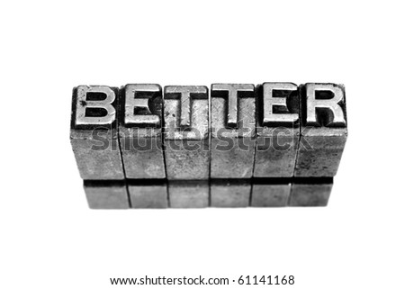 BETTER written in metallic letters on a white background - stock photo