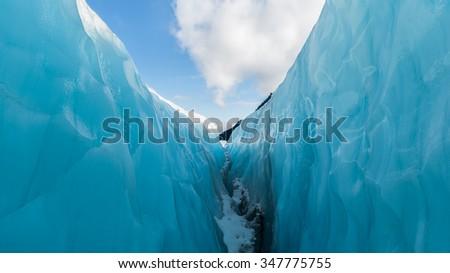 Between ice and sky, Fox Glacier, New Zealand. - stock photo